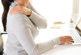 Woman with hands holding her shoulder pain. Office syndrome and Chiropractic care concept.